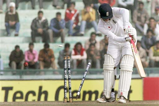 Graeme Swann is bowled out off Zaheer Khan's delivery during fourth day of second Test match between India and England in Mohali on Monday. (AP Photo)