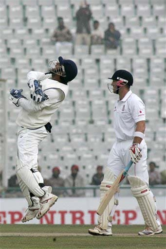 Mahendra Singh Dhoni celebrates dismissal of Matt Prior during the fourth day of the second Test match between India and England in Mohali on Monday. (AP Photo)