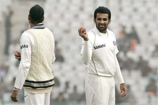 Zaheer Khan talks to team-mate Harbhajan Singh during fourth day of second Test match between India and England in Mohali on Monday. (AP Photo)