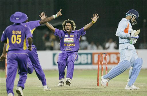 Lasith Malinga celebrates the dismissal of Virender Sehwag with teammates during the Twenty20 match between India and Sri Lanka in Colombo. (AP Photo)