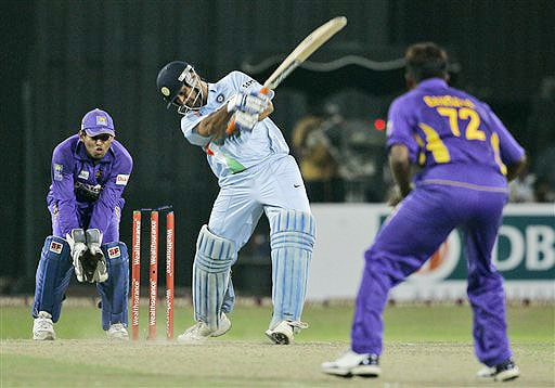 Mahendra Singh Dhoni misses a shot as his bails are dislodged while Malinga Bandara looks on during the Twenty20 match between India and Sri Lanka in Colombo. (AP Photo)