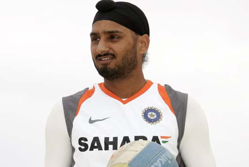 Spin bowler Harbhajan Singh of the Indian Cricket team prepares to serve during a beach volleyball game on Sydney's Bondi Beach on Tuesday, January 8, 2007.