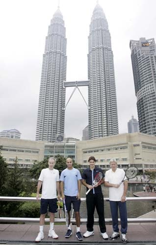 American John McEnroe, American James Blake, Switzerland's Roger Federer, and Swedish Bjorn Borg pose in front of Malaysia's landmark Petronas Twin Towers in Kuala Lumpur, Malaysia on Monday. They visited Malaysia for the Showdown of Champions Kuala Lumpur 2008 exhibition matches on Tuesday.