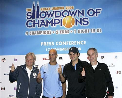 Swedish Bjorn Borg, American James Blake, Swiss Roger Federer, and American John McEnroe show thumbs up after a press conference in Kuala Lumpur, Malaysia on Monday. They visited Malaysia for the Showdown of Champions Kuala Lumpur 2008 exhibition matches on Tuesday.