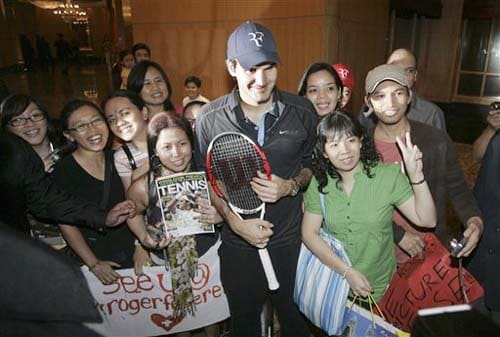 Swiss Roger Federer poses with fans after a press conference in Kuala Lumpur, Malaysia on Monday.