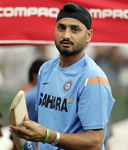 India spinner Harbhajan Singh checks a bat during practice session at The R Premadasa Stadium in Colombo on Wednesday. (AP Photo)