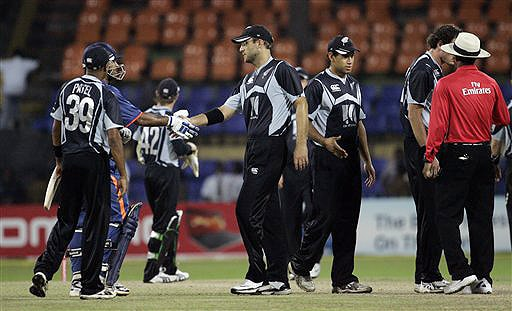 New Zealand captain Daniel Vettori shakes hands with Indian captain Mahendra Singh Dhoni, after India beat Kiwis by 6 wickets in the ODI match for the tri-nation series in Colombo on Friday, September 11, 2009. Sri Lanka is the third team in the series. (AP Photo)