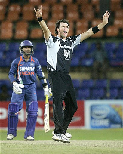 New Zealand's Kyle Mills appeals successfully for the dismissal of India's Dinesh Karthik during their ODI match for the tri-nation series in Colombo on Friday. (AP Photo)