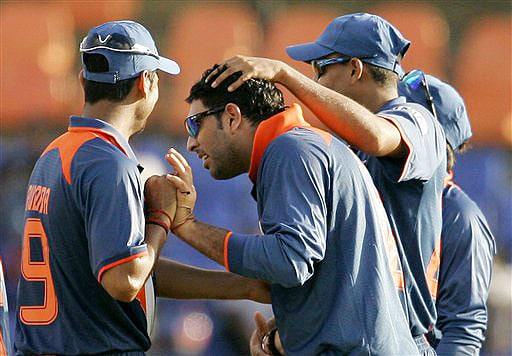 Indian cricketers congratulate teammate Yuvraj Singh after he dismissed New Zealand's Neil Broom during their ODI match for the tri-nation series in Colombo on Friday. (AP Photo)