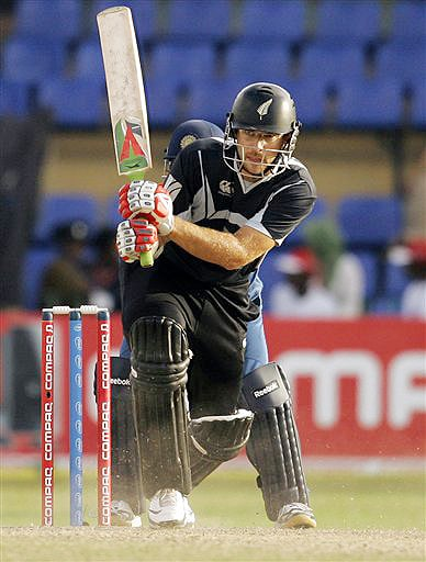 New Zealand captain Daniel Vettori bats during the ODI match between India and New Zealand for the tri nation series in Colombo on Friday. (AP Photo)