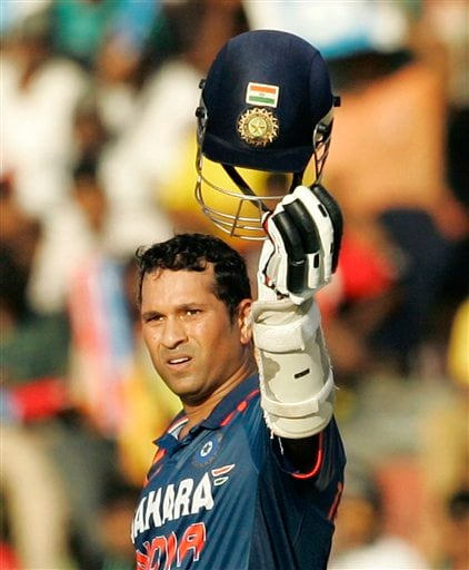 India's Sachin Tendulkar acknowledges the crowd after scoring a century during the Tri-Nation Championship Trophy final ODI match against Sri Lanka in Colombo on Monday. (AP Photo)