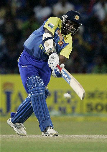 Sri Lanka's Sanath Jayasuriya plays a shot during the Tri-Nation Championship Trophy final ODI match against India in Colombo on Monday. (AP Photo)