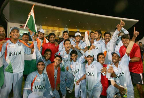 <b>Celebration time:</b> The India team pose after winning the ICC U/19 Cricket World Cup final match against South Africa at Kinrara Oval in Kuala Lumpur, Malaysia (© AP)