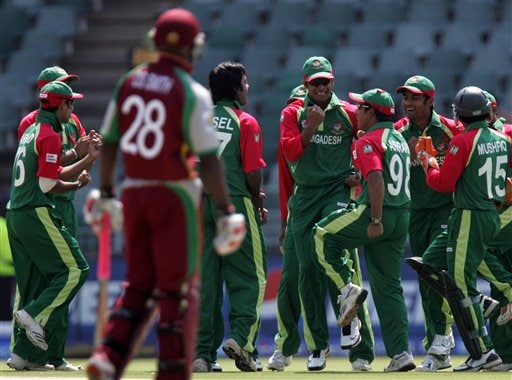 Bangladesh's players celebrate the dismissal of West Indies batsman Chris Gayle, unseen, for a duck during their Twenty20 World Championship cricket match against West Indies at the Wanderers Stadium in Johannesburg, South Africa, Thursday, Sept. 13, 2007.