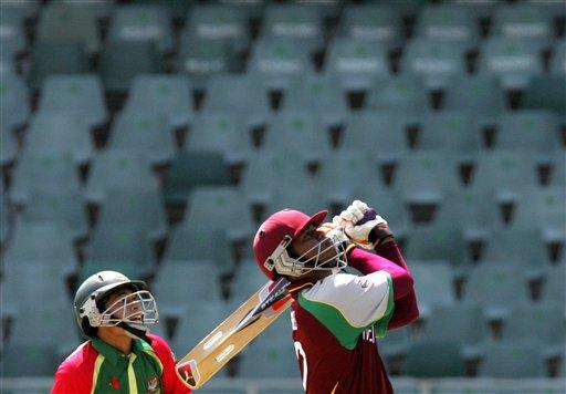 West Indies batsman Marlon Samuels, right, watches his shot as Bangladesh's wicketkeeper Mushfiqur Rahim, left, looks on during their Twenty20 World Championship cricket match against Bangladesh at the Wanderers Stadium in Johannesburg, South Africa, Thursday, Sept. 13, 2007.