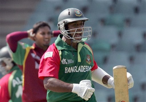 Bangladesh's batsman Aftab Ahmed, right, celebrates as teammate Alok Kapali, partially seen left, , makes a winning run whilst West Indies bowler Ravi Rampaul, left, looks on at the end of their Twenty20 World Championship cricket match against West Indies at the Wanderers Stadium in Johannesburg, South Africa, Thursday, Sept. 13, 2007. Bangladesh won by 6 wickets.