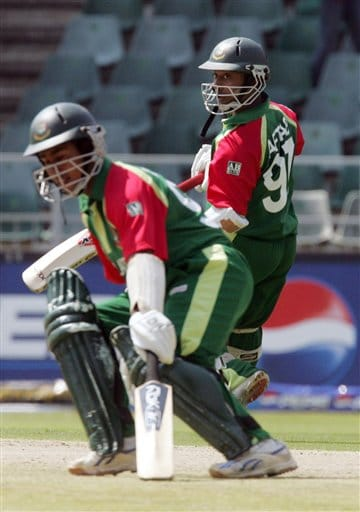 Bangladesh's batsman Aftab Ahmed, right, with teammate captain Mohammad Ashraful, left, run between the wickets during their Twenty20 World Championship cricket match against West Indies at the Wanderers Stadium in Johannesburg, South Africa, Thursday, Sept. 13, 2007.