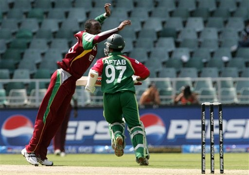 Bangladesh's batsman Aftab Ahmed, right, avoids colliding with West Indies' bowler Fidel Edwards, left, as he makes a run during their Twenty20 World Championship cricket match against West Indies at the Wanderers Stadium in Johannesburg, South Africa, Thursday, Sept. 13, 2007.