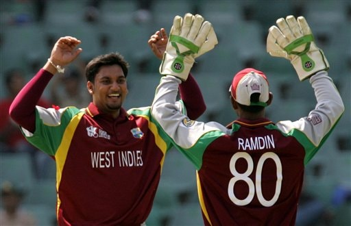 West Indies' bowler Ravi Rampaul, left, celebrates with teammate wicketkeeper Denesh Ramdin, right, for dismissing Bangladesh's batsman Tamim Iqbal, unseen, for 10 runs during their Twenty20 World Championship cricket match against Bangladesh at the Wanderers Stadium in Johannesburg, South Africa, Thursday, Sept. 13, 2007.