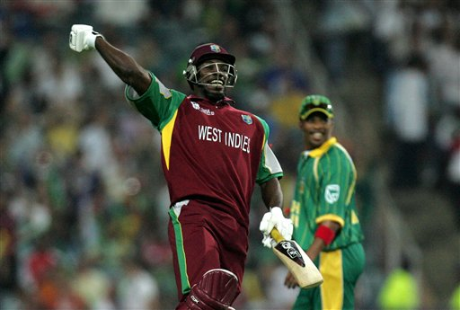 West Indies batsman Chris Gayle, left, celebrates his century as South Africa's bowler, right, looks on during their Twenty20 World Championship cricket match against South Africa at the Wanderers Stadium in Johannesburg, South Africa, Tuesday, Sept. 11, 2007. Gayle holds the record for most number of sixes in Twenty20 games. He has hit six sixes so far, overtaking Ponting, Martyn, Gilchrist and Nazimuddin (of Bangladesh) who hit five sixes.