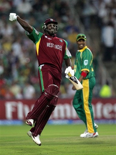 West Indies batsman Chris Gayle, left, celebrates his century as South Africa's bowler, right, looks on during their Twenty20 World Championship cricket match at the Wanderers Stadium in Johannesburg, South Africa, Tuesday, Sept. 11, 2007. Gayle holds the record for the most number of sixes in Twenty20 games. He has hit six sixes so far, overtaking Ponting, Martyn, Gilchrist and Nazimuddin (of Bangladesh) who hit five sixes.