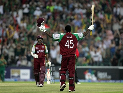 West Indies batsman Chris Gayle, right, celebrates his century as teammate Shivnarine Chanderpaul, left, looks on during their Twenty20 World Championship cricket match against South Africa at the Wanderers Stadium in Johannesburg, South Africa, Tuesday, Sept. 11, 2007. Gayle holds the record for most number of sixes in Twenty20 games. He has hit six sixes so far, overtaking Ponting, Martyn, Gilchrist and Nazimuddin (of Bangladesh) who hit five sixes.