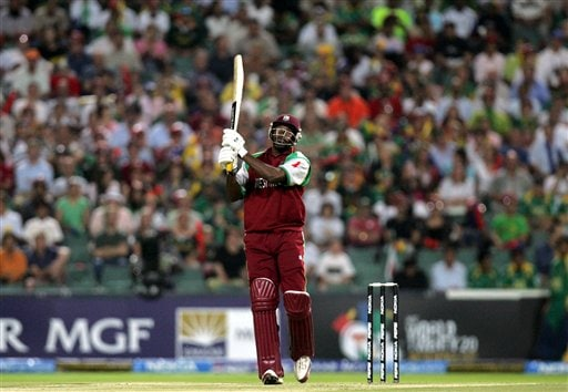 West Indies batsman Chris Gayle watches his shot as he scores six during their Twenty20 World Championship cricket match against South Africa at the Wanderers Stadium in Johannesburg, South Africa, Tuesday, Sept. 11, 2007.
