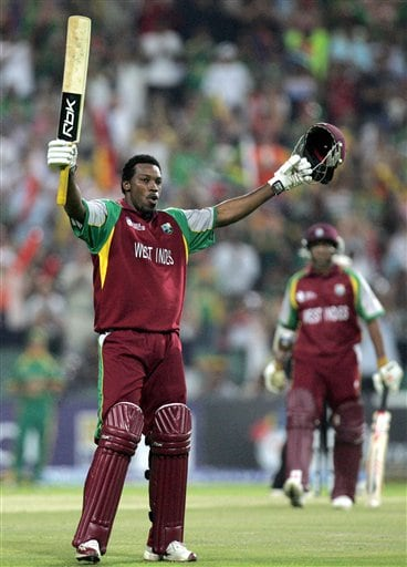 West Indies batsman Chris Gayle, left, celebrates his century as teammate Shivnarine Chanderpaul, right, looks on during their Twenty20 World Championship cricket match against South Africa at the Wanderers Stadium in Johannesburg, South Africa, Tuesday, Sept. 11, 2007.