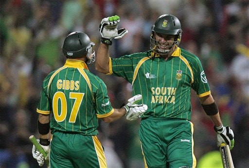South Africa's batman Justin Kemp, right, celebrates with teammate Herschelle Gibbs, left, after winning their Twenty20 World Championship cricket match against West Indies at the Wanderers Stadium in Johannesburg, South Africa, Tuesday, Sept. 11, 2007. South Africa won by 8 wickets with 14 balls remaining.