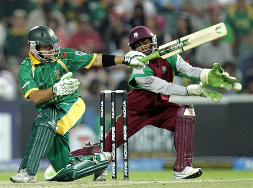 South Africa's batsman Herschelle Gibbs, left, plays a side shot as West Indies wicketkeeper Denesh Ramdin, right, looks on during their Twenty20 World Championship cricket match against West Indies at the Wanderers Stadium in Johannesburg, South Africa, Tuesday, Sept. 11, 2007.