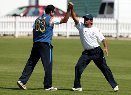 MS Dhoni, right, high fives with Irfan Pathan during a net practice at Lord's cricket ground in London. (AP Photo)