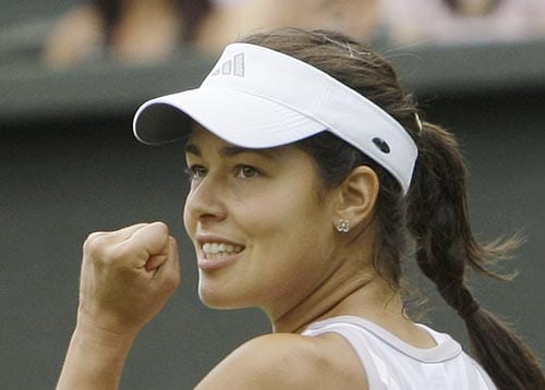 Ana Ivanovic of Serbia reacts as she defeats Rossana De los rios of Paraguay, during their Women's Singles, first round match on the Centre Court at Wimbledon.