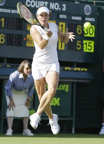 Canada's Stephanie Dubois returns to Anna Chakvetadze of Russia, during their women's singles first round match at Wimbledon.