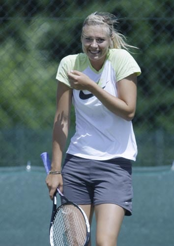 Maria Sharapova of Russia reacts to a misdirected shot while practicing at Wimbledon on Sunday.