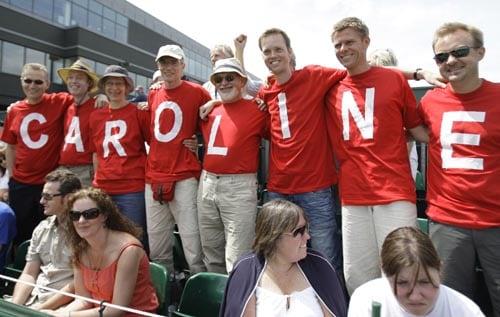 Supporters of Denmark's Caroline Wozniacki watch her during her women's singles first round match against Eva Hrdinova of the Czech Republic.