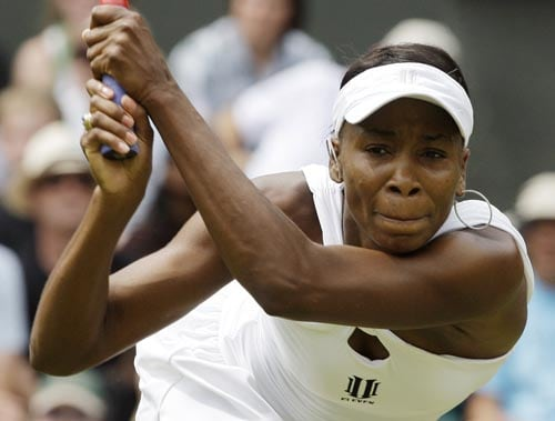 Defending women's champion Venus Williams of the US returns to Britain's Naomi Cavady on the Centre Court.