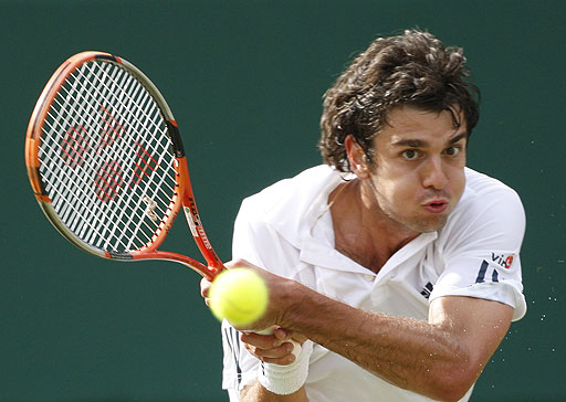 Croatia's Mario Ancic in action during his quarterfinal against Switzerland's Roger Federer at Wimbledon on July 2, 2008.