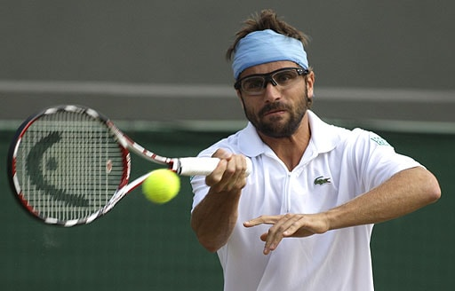 France's Arnaud Clement returns to Rainer Schuettler of Germany, during their men's singles quarterfinal on the Centre Court at Wimbledon on July 2, 2008.