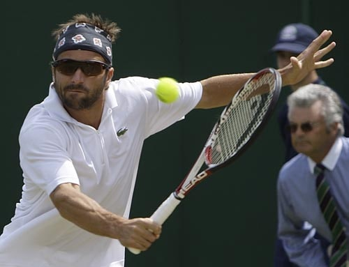 France's Arnaud Clement returns to Germany's Benjamin Becker during their Men's Singles, second round match at Wimbledon.