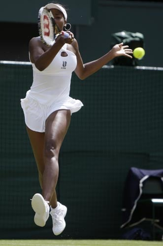 Venus Williams of the US in action during her second round match against Britain's Anne Keothavong at Wimbledon.
