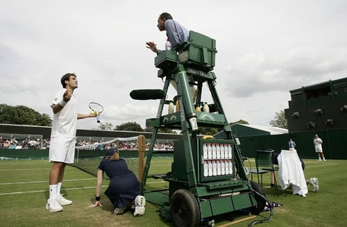 Germany's Tommy Haas dispoutes a point with the umpire, during his Men's Singles, second round match against Spain's Tommy Robredo at Wimbledon.