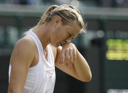 Russia's Maria Sharapova reacts during her second round match against Russia's Alla Kudryavtseva at Wimbledon.