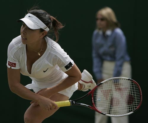 China's Zheng Jie serves to Hungary's Agnes Szavay, during their Women's Singles, fourth round match at Wimbledon.