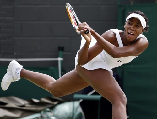 Venus Williams of the US in action during her fourth round match against Russia's Alisa Kleybanova at Wimbledon.
