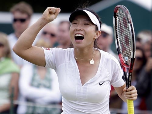 China's Zheng Jie celebrates after her fourth round match against Hungary's Agnes Szavay at Wimbledon.