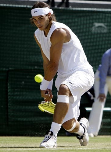 Rafael Nadal of Spain in action during his fourth round match against Russia's Mikhail Youzhny at Wimbledon.