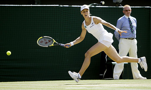 Elena Dementieva in action during her quarterfinal match against compatriot Nadia Petrova on the Centre Court at Wimbledon.