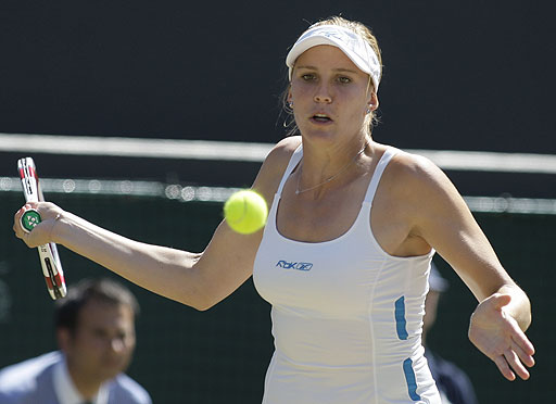 Nicole Vaidisova of the Czech Republic returns to China's Zheng Jie during their Women's singles quarterfinal on the Number One Court at Wimbledon.