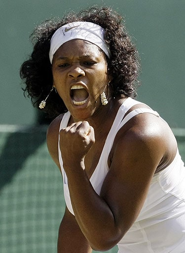 Serena Williams of the US reacts during her quarterfinal match against Poland's Agnieszka Radwanska on the Centre Court at Wimbledon.