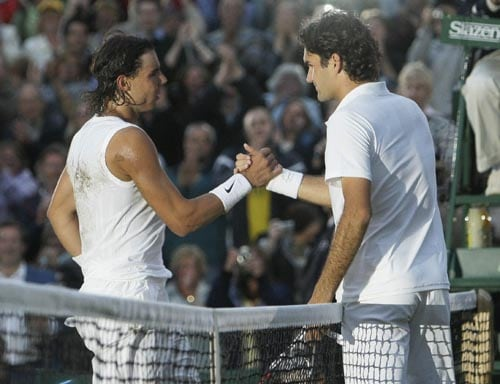 Spain's Rafael Nadal left, shakes the hand of Switzerland's Roger Federer after winning the men's final on the Centre Court at Wimbledon.